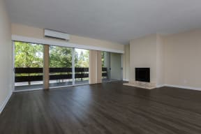 Living area with fireplace and sliding glass doors to balcony