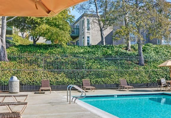 Pool seating at Baycliff Apartments in Richmond, CA