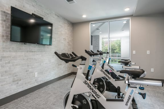 High-Tech Fitness Center With TV at Azure Houston Apartments, Texas