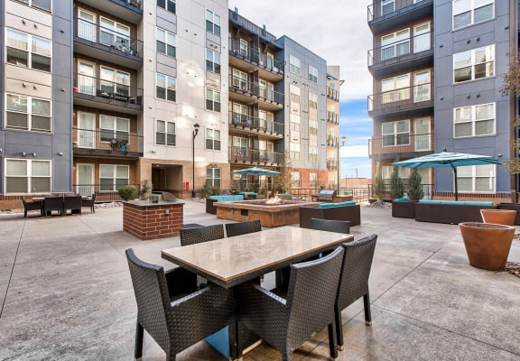 Courtyard with fire pit and grills at Windsor at Broadway Station, Denver, CO