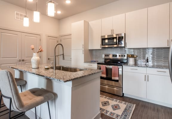 The Mezz at Fiddler's Green Apartments Model Kitchen with Island