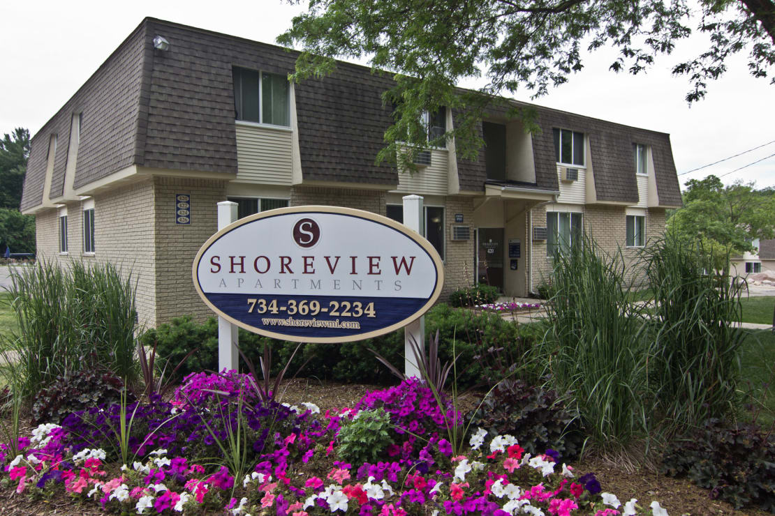 Shoreview Apartments Exterior monument sign with purple flowers