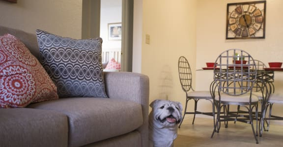 Dining area and living room at Sunset Landing Apartments in Glendale AZ
