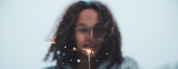 Person holding sparkler at Caviata at Kiley Ranch Apartments in Nevada