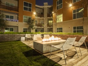 Fire Pit Seating Apartments in San Mateo| Mode Apartments