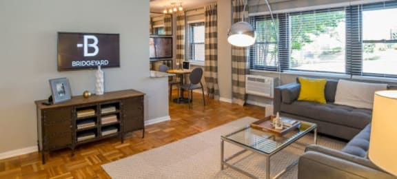 Open living area with large windows at Bridgeyard in Alexandria, VA