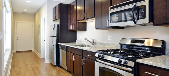 Spacious Kitchen with Pantry Cabinet at The Belmont by Reside Flats, Chicago, IL,60657