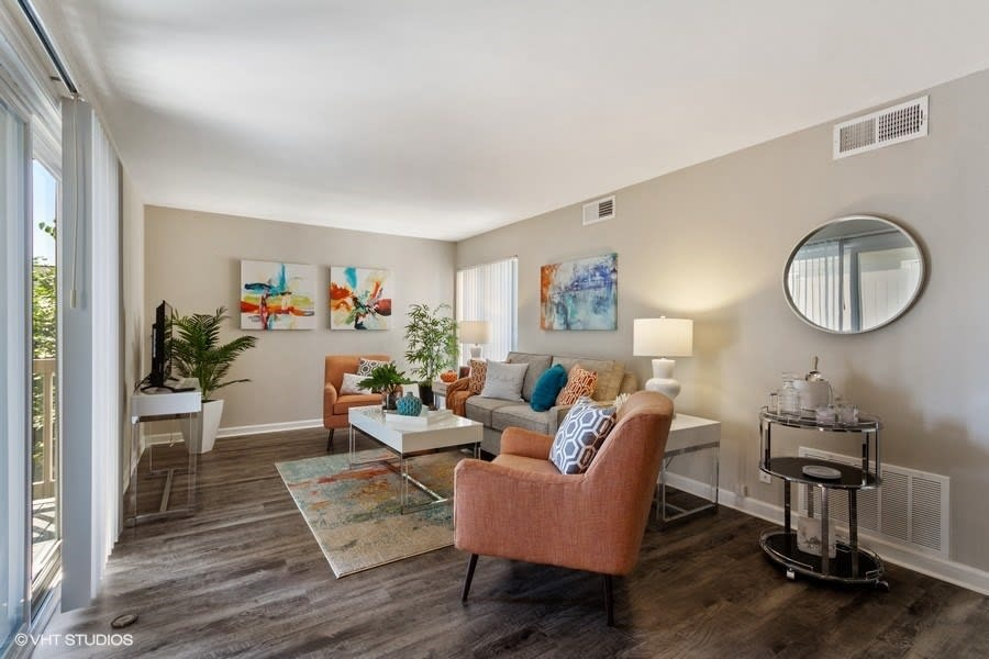Bright living space with plank wood flooring