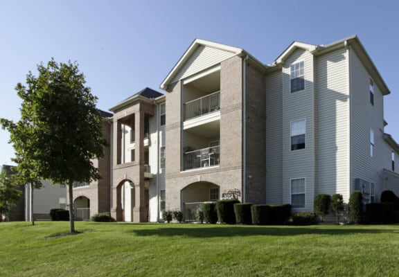 Exterior view of Waterford at Summit View, including lush landscaping and private balconies and patios.