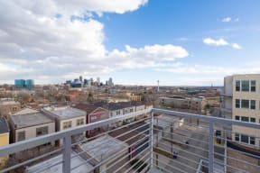 Balcony view of Denver skyline from 2828 Zuni Apartments