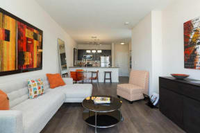 Spacious living and open dining area at 2828 Zuni Apartments