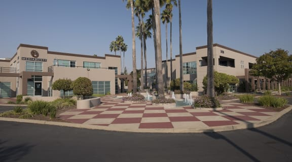 Sierra Business Center buildings with courtyard fountain and palm trees