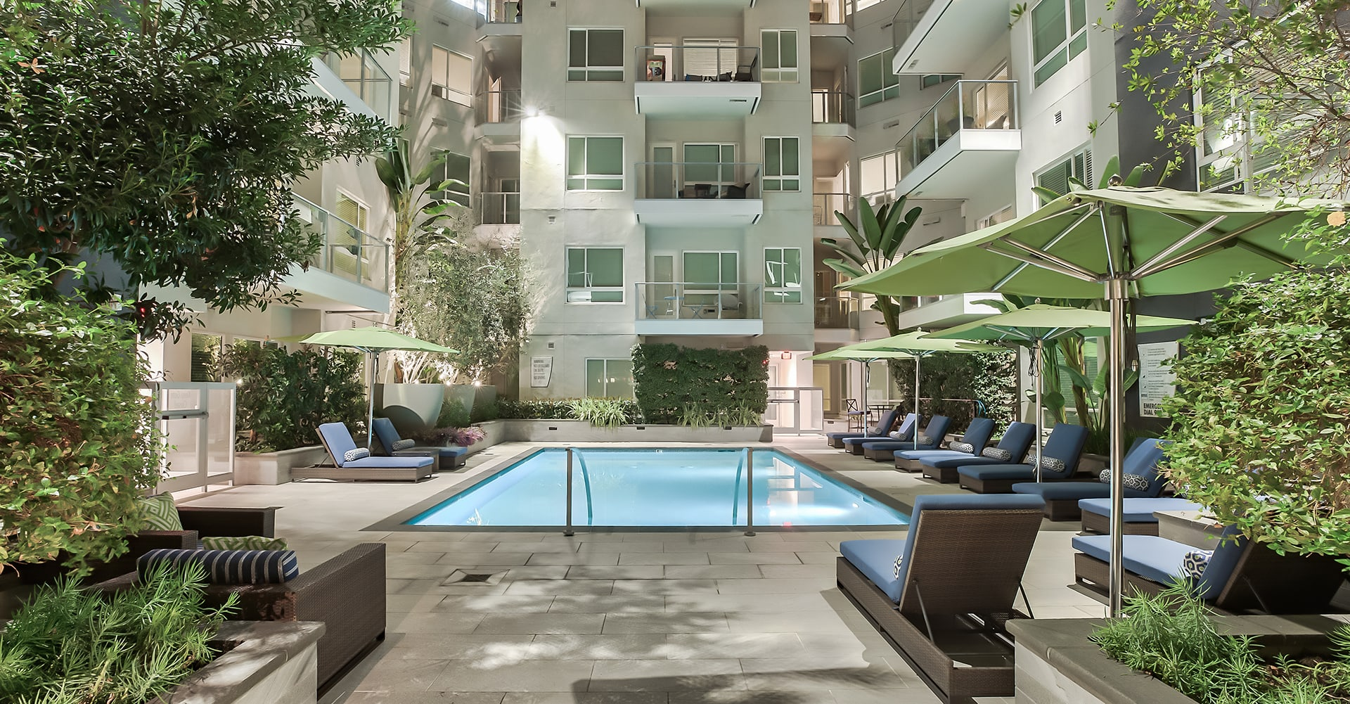 Pool, sundeck and lounge chairs at Olympic by Windsor, 936 S. Olive St, 90015