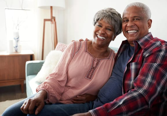 Senior Lifestyle_Couple Smiling - Couch