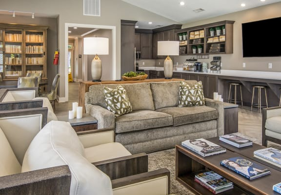 Luxurious resident-exclusive Legacy at River Crossing clubhouse with communal kitchen, TV and library in Macon, GA rentals