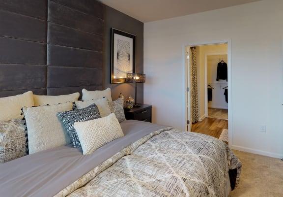Bedroom with ceiling fan; window; door to in-room bathroom
