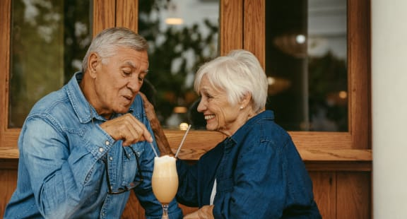 couple enjoying drinks at Morning View Terrace Apartment Homes, Escondido California, 92026