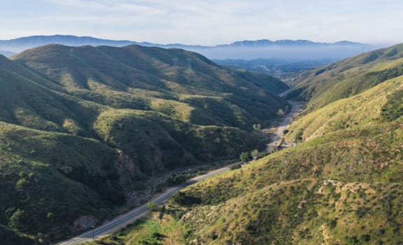 Mountain Range with Road Winding In-between