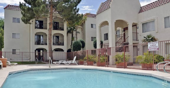 Exterior, landscaping, pool & pool patio at Univeristy Park Apartments in Tempe, AZ