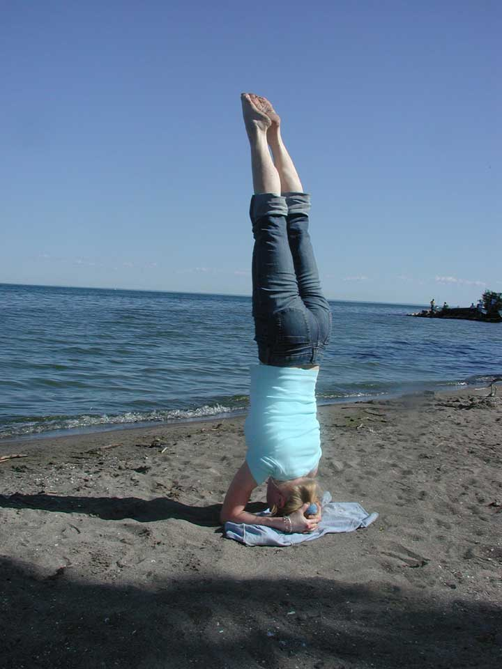 headstand at beach