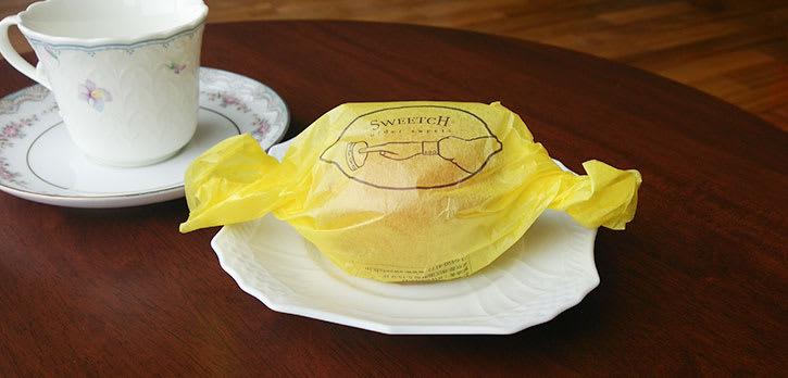画像:薄葉紙 菊の印刷事例 レモンケーキ / 包装紙(SWEETCH様)