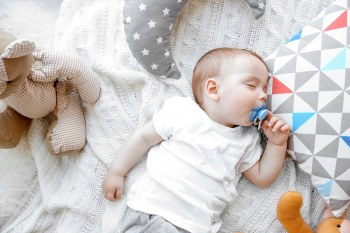 Baby sleeping on crib mattress