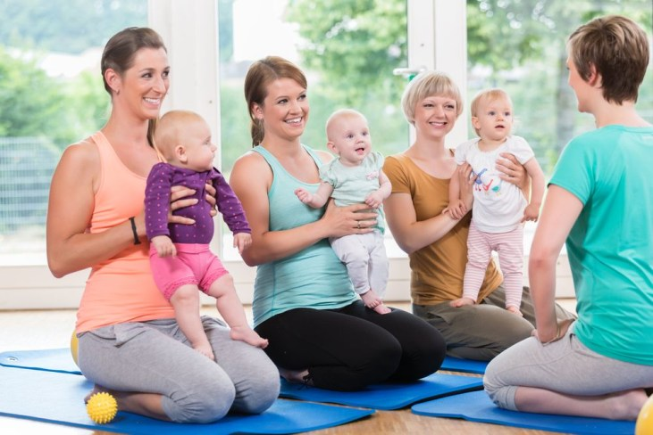 Women and their babies in mother-child gymnastic course