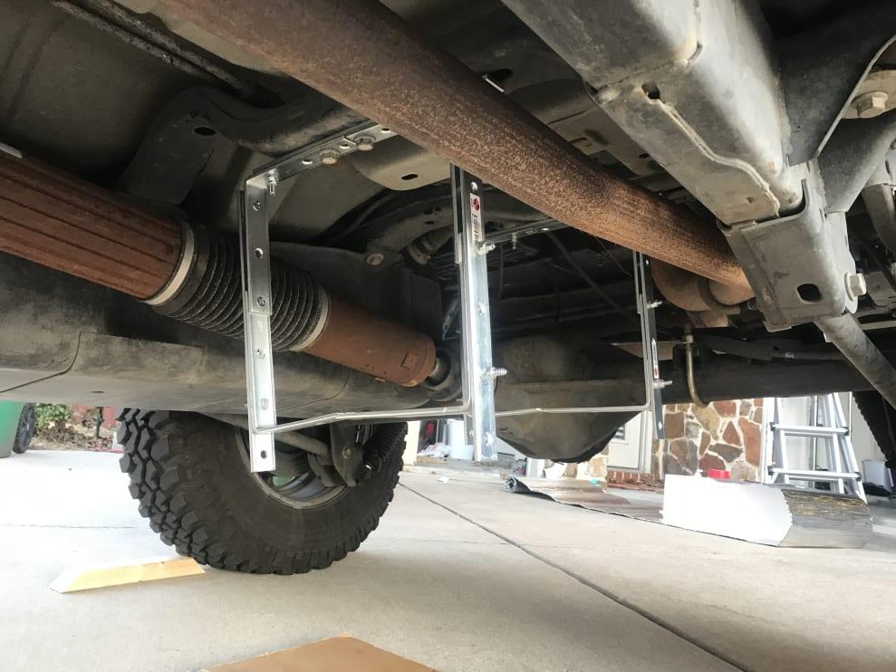 Water tank brackets under Jeep JKUR