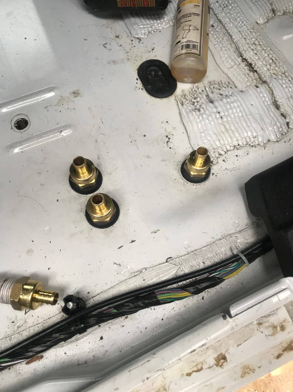 Brass fittings installed in a Jeep for water tank installation