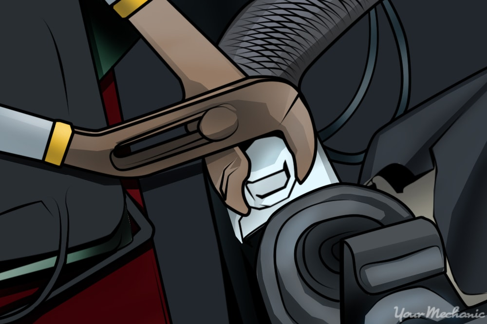 pliers being used to loosen radiator hose