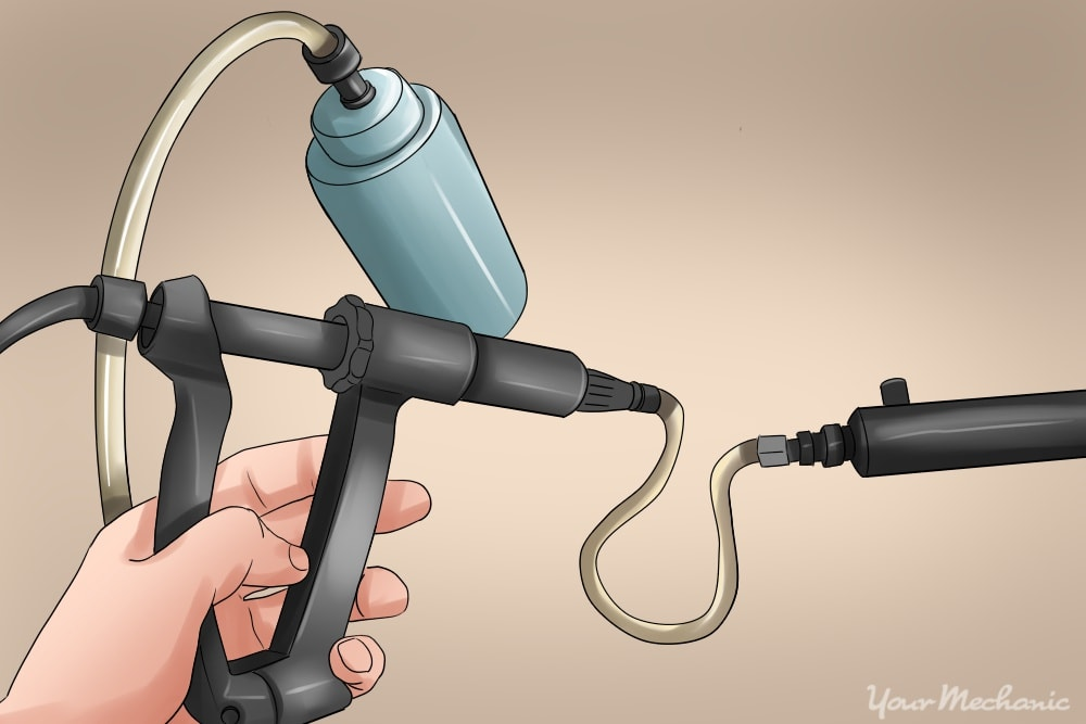 hand operating the vacuum pump