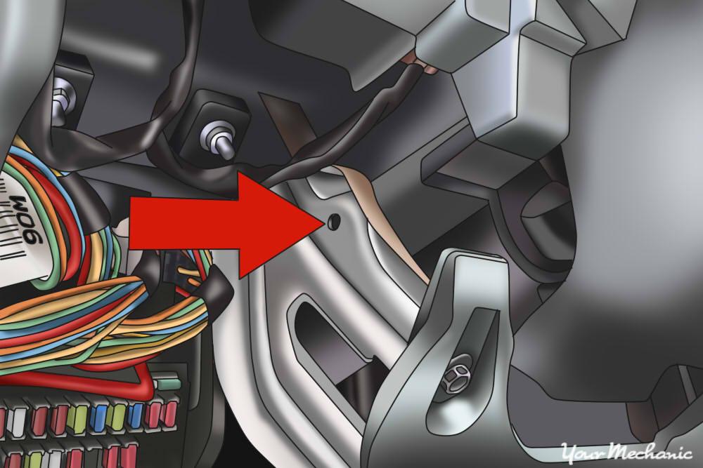 metal underneath steering wheel