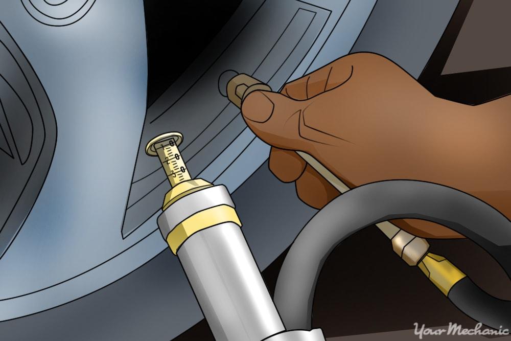 person checking tire pressure