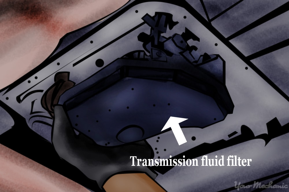 person pulling transmission filter from transmission