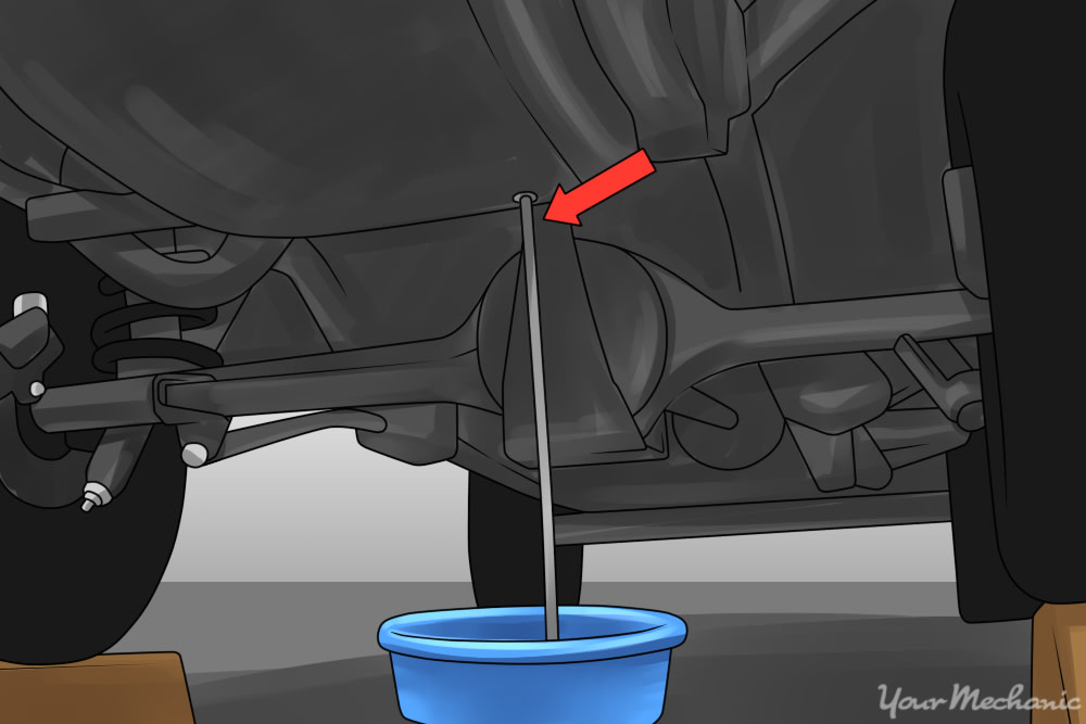 draining the excess fuel from the fuel line show fuel draining into a drain pan
