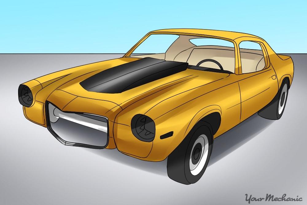 yellow camaro body added to frame