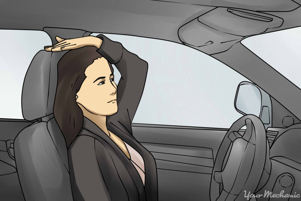 person adjusting headrest