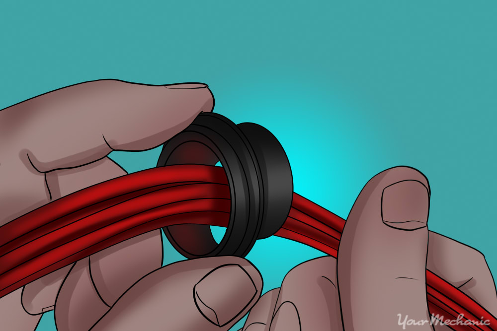 rubber grommet wrapped around control cable