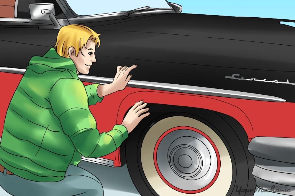 man installing new chrome to car