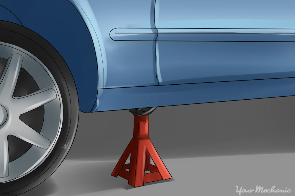jack stand placed under vehicle