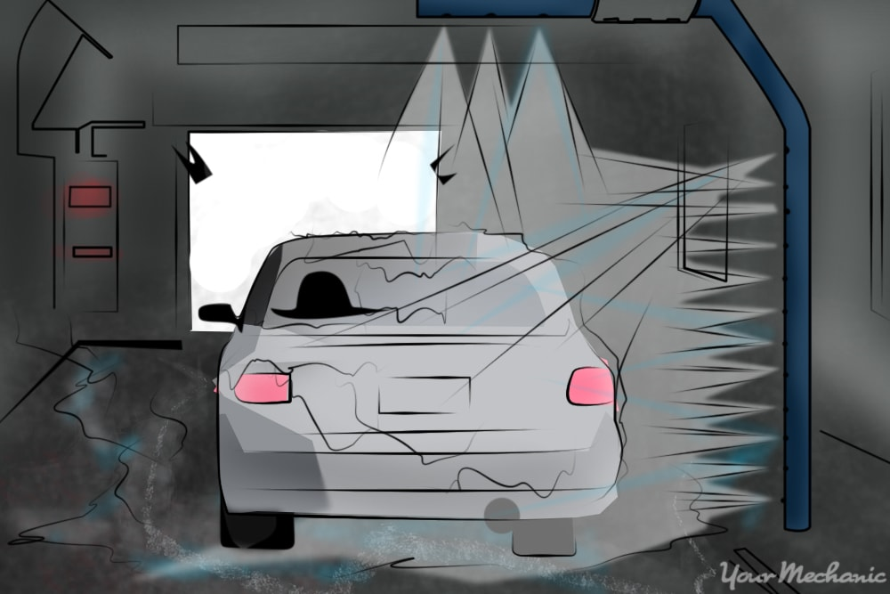 car going through touchless car wash