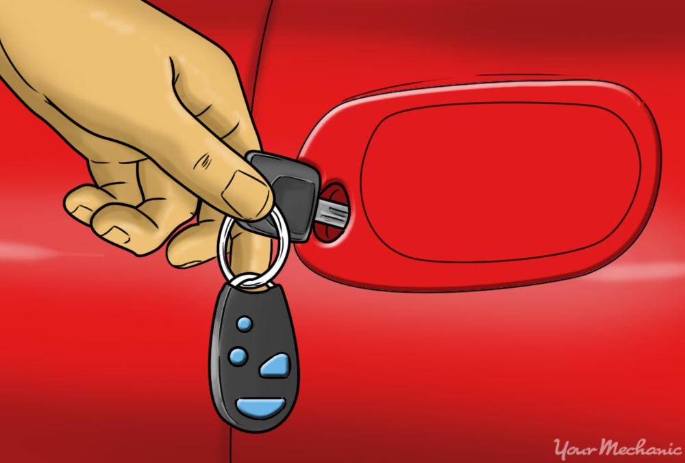 key in the car door testing the lock
