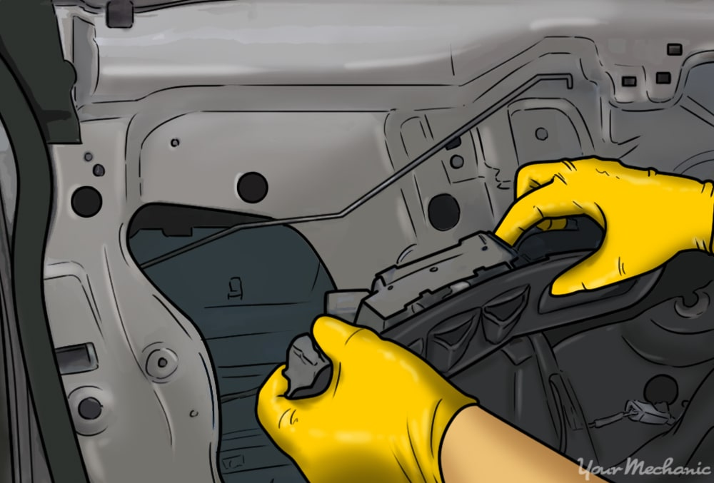 hands testing the window without the door panel