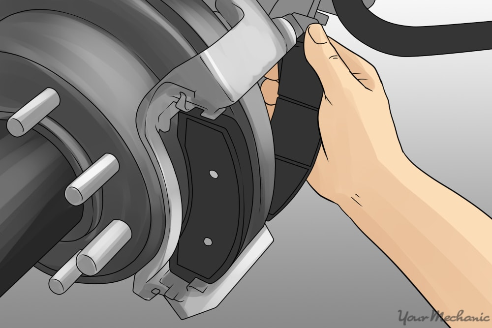person installing new brake pads