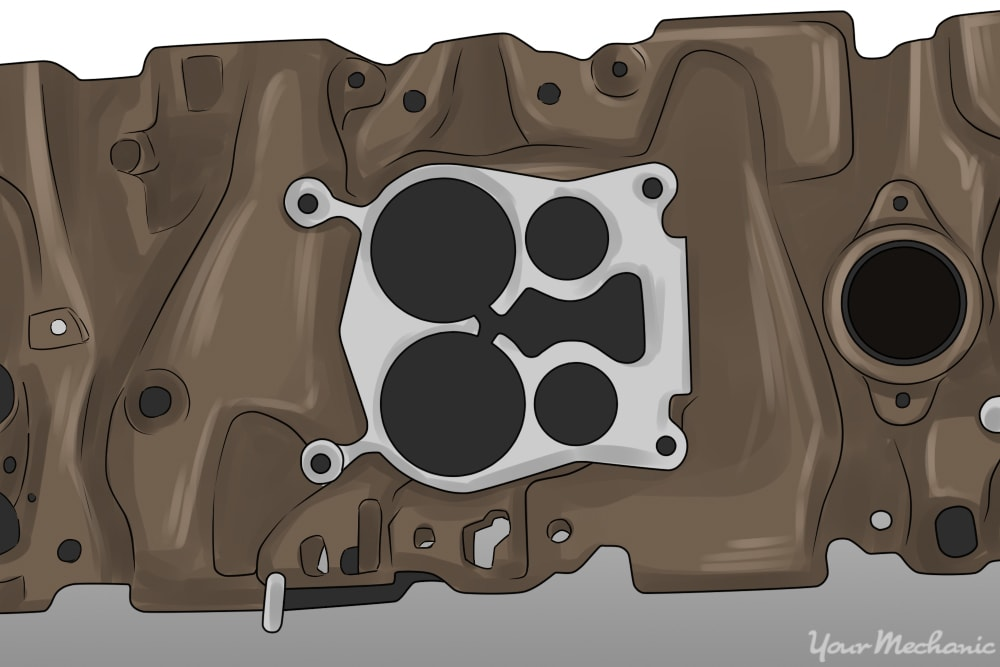 carburetor mounting flange on the intake manifold
