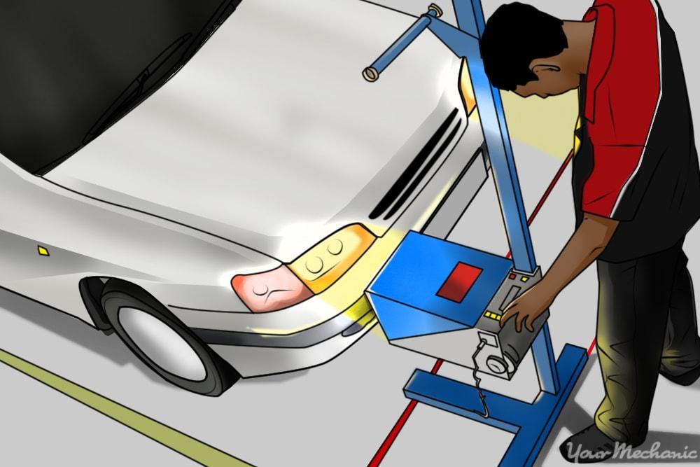 mechanic inspecting headlights