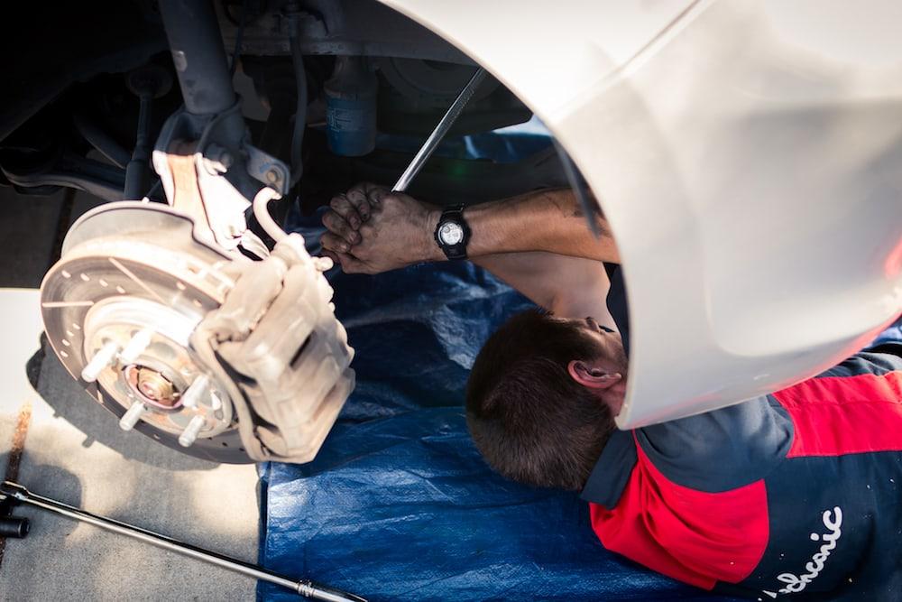 mark under car with big ratchet