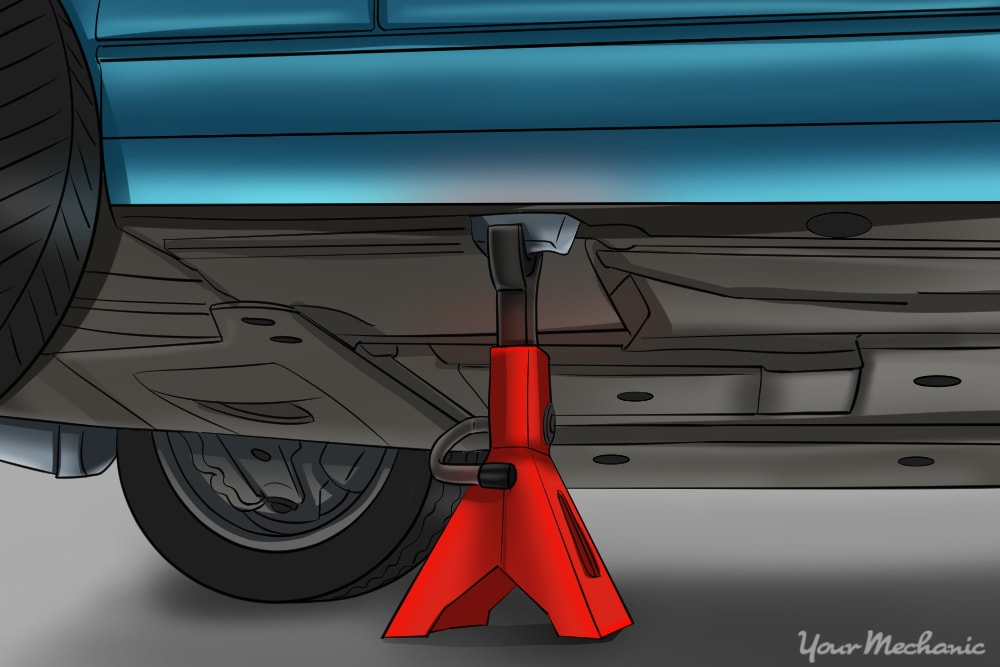 jack stand placed under car