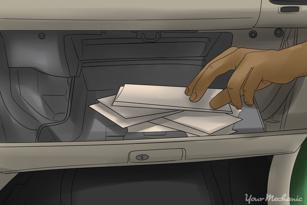 person removing items from glove box