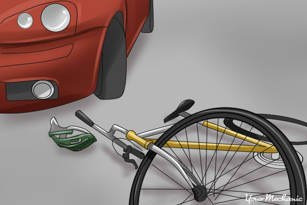 bike and helmet laying on the ground